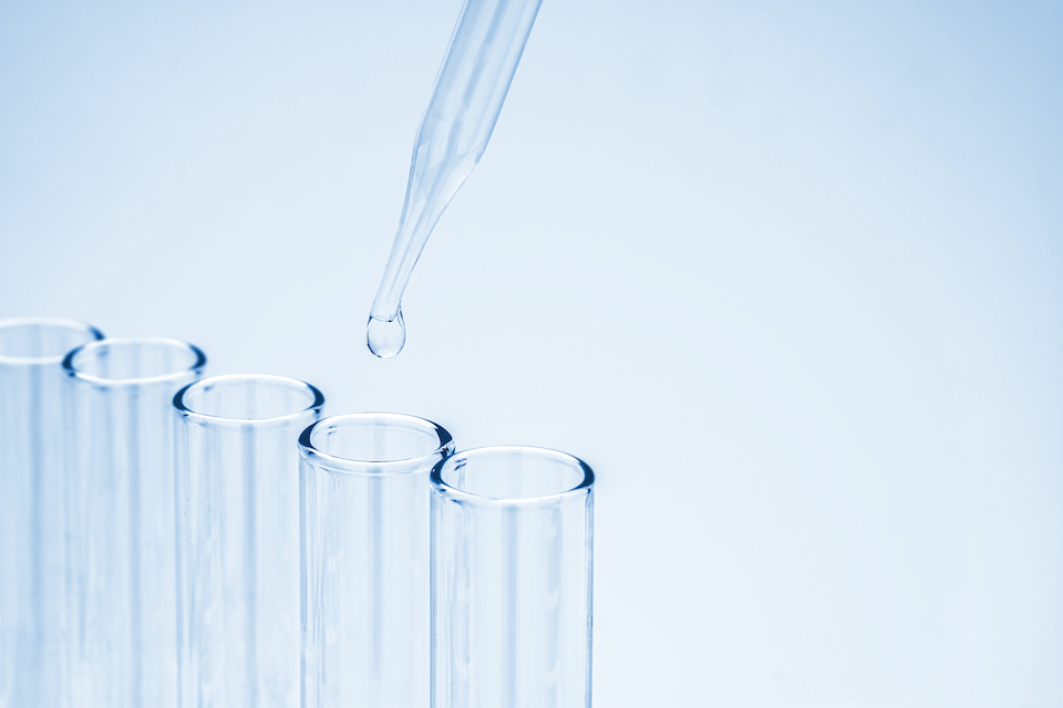 Pipette drop chemical to the laboratory glassware, Chemistry science research and development concept