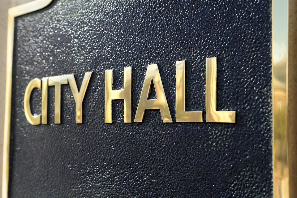 City Hall nameplate on a local government building.